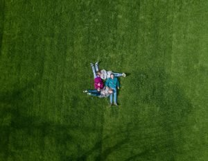 Family on grass thinking